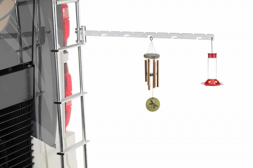 The Ladder Gadget holding wind chimes on RV